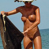 Soaked pussies, large boobs, astonishing butts and large tanned ramrods on the beach.