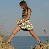 Hot legal age teenager beauty on the seaside getting out of her military styled dress.
