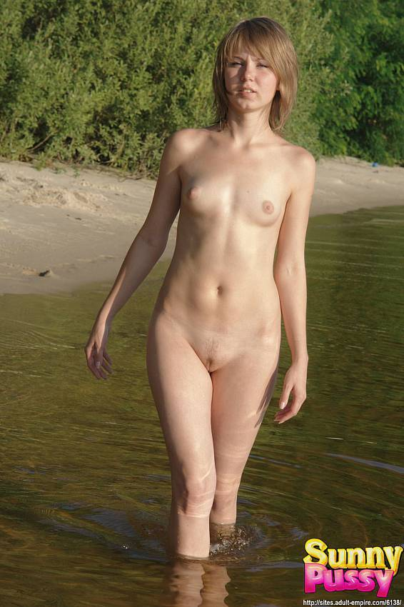 smiling young blonde undressing and having nude fun in the